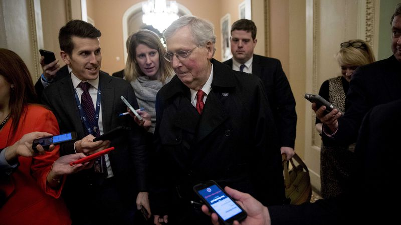 Senate Majority Leader Mitch McConnell leaves for the day after two Senate bills to end the...