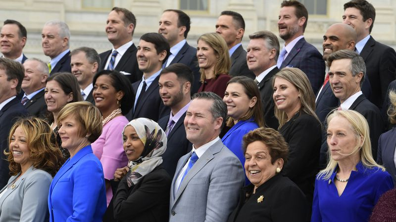Members of the freshman class of Congress pose for a photo opportunity on Capitol Hill in...