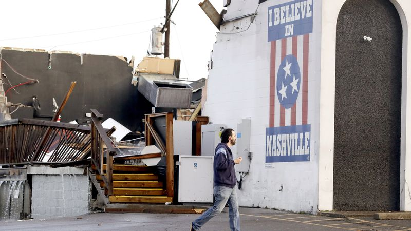 A man walks by The Basement East, a live music venue destroyed by storms Tuesday, March 3,...