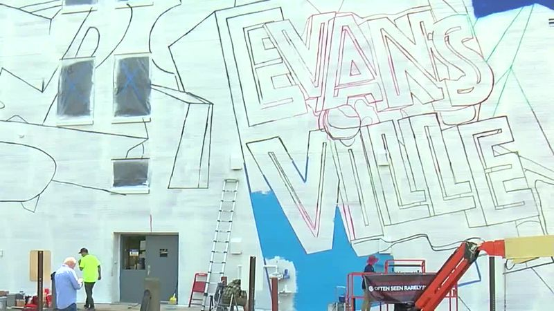 Louisville artist group painting large mural in downtown Evansville