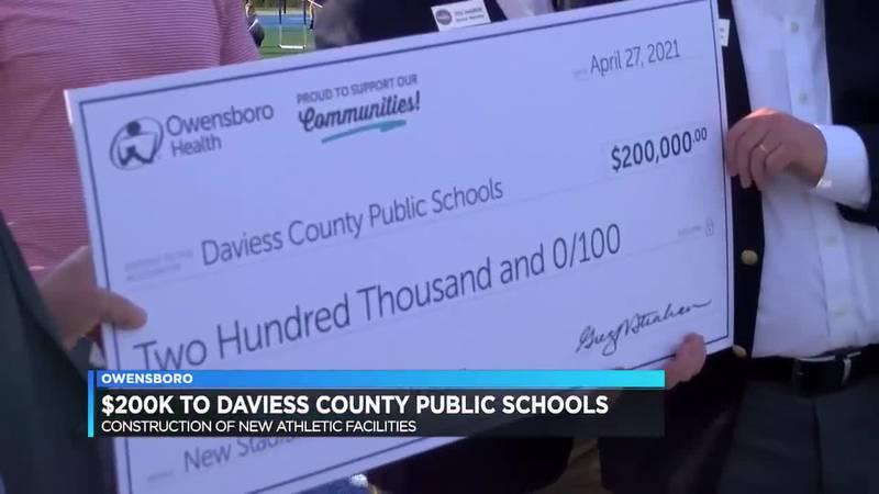 Owensboro Health presents $200K check to DCPS