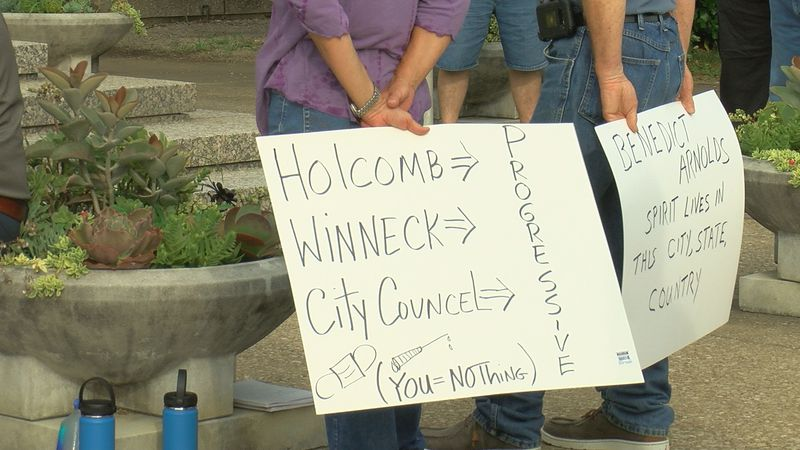 Maskless protesters gather in downtown Evansville to oppose mask mandate.