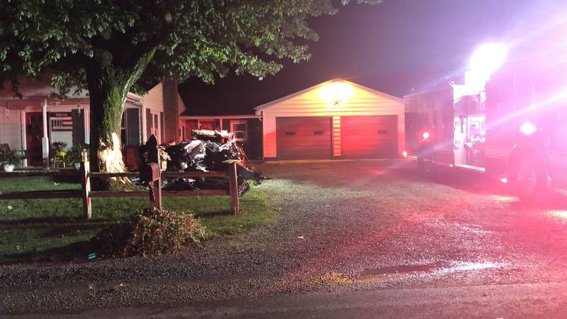 One person is dead after authorities say a car hit a tree in front of a house along South...