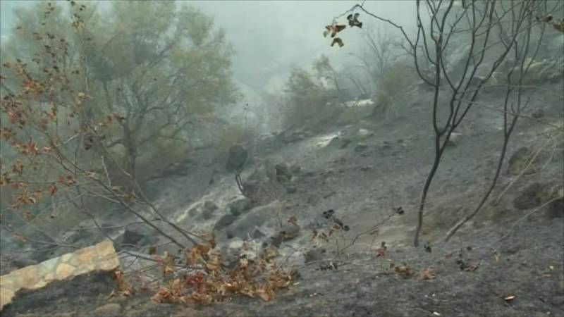 Officials say the fire intensity was reduced as it moved into areas where prescribed fire...