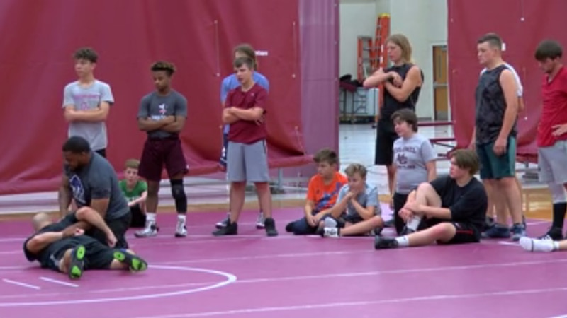 Lindsey Wilson College head wrestling coach Jameel Bryant hosted a wrestling camp for middle...