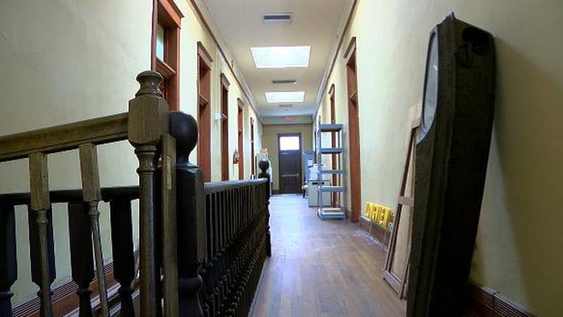 Museum Volunteers say they hear what could be a little girl walking around an iron coffin.