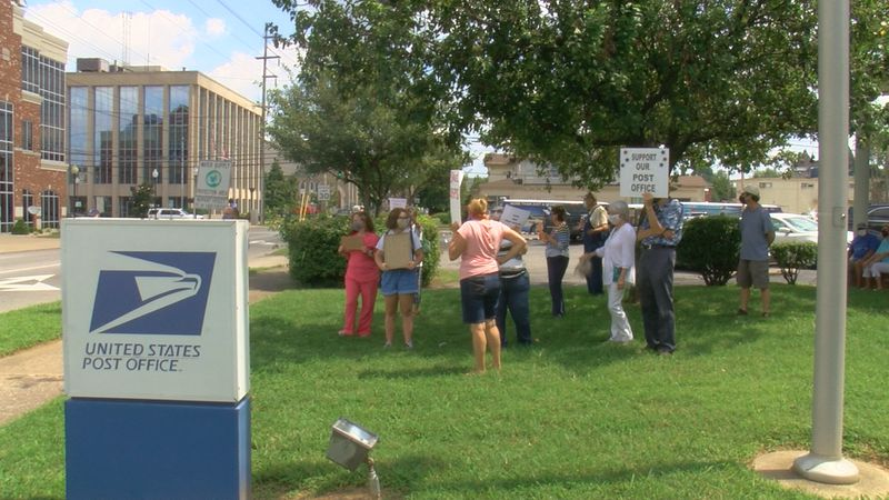 Protestors rallied in support of the U.S. postal service. A couple dozen people gathered on 4th...