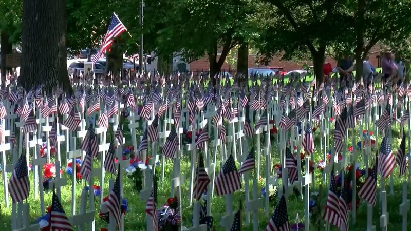 Over 5,500 crosses fill Central Park in Henderson as part of Memorial Day service.