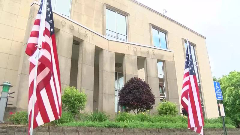 Daviess Co. Courthouse lined with flags in preparation for Walk of Honor event