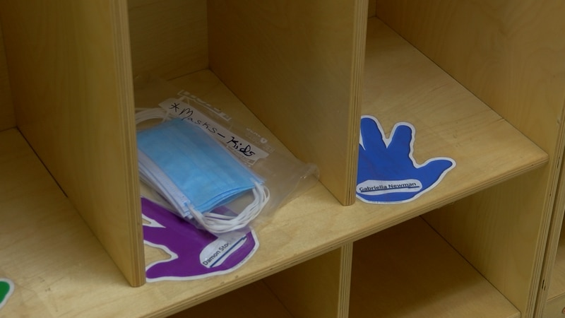 A stack of masks placed in the cubby of a student at a Carmi-White County elementary school.