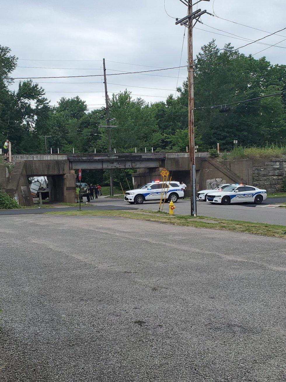 Box truck hits train bridge