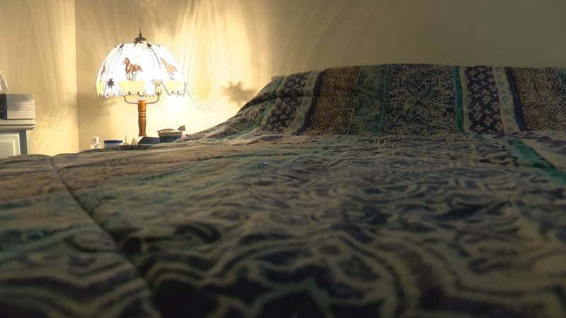 An Evansville woman woke up to a strange man in her bedroom.