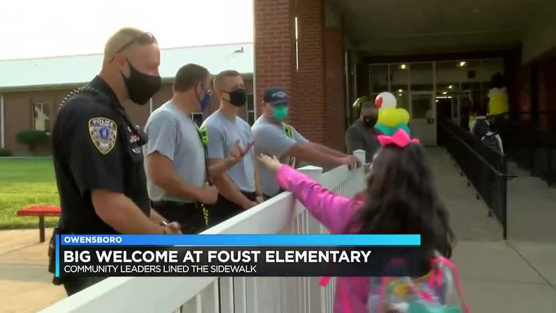 Community leaders welcome back students at Foust Elementary.