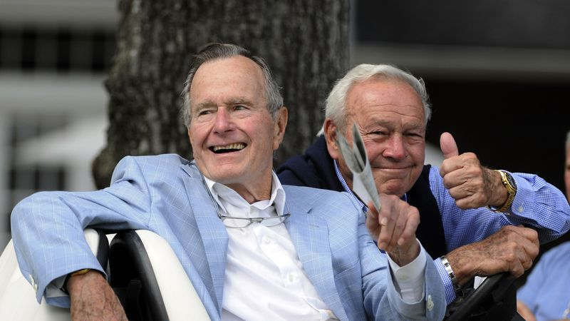 FILE - In this Oct. 22, 2010, file photo, Former President George H. W. Bush, left, and golfing...