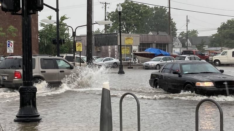 Heavy rain flooding streets in Evansville