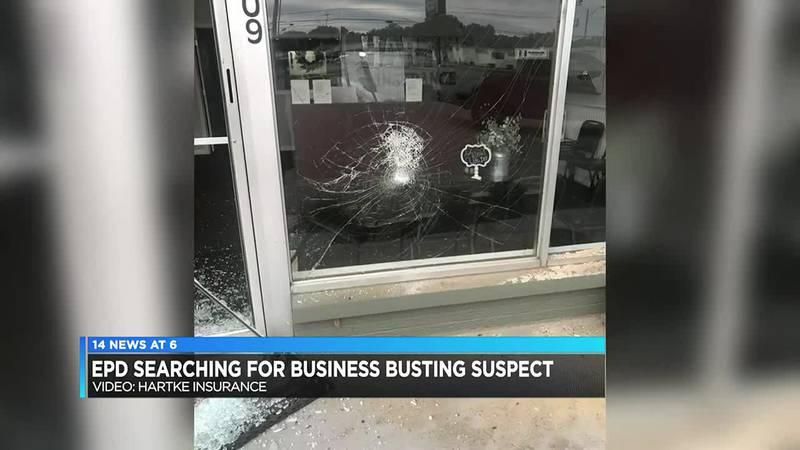 Man caught on camera breaking windows with bike