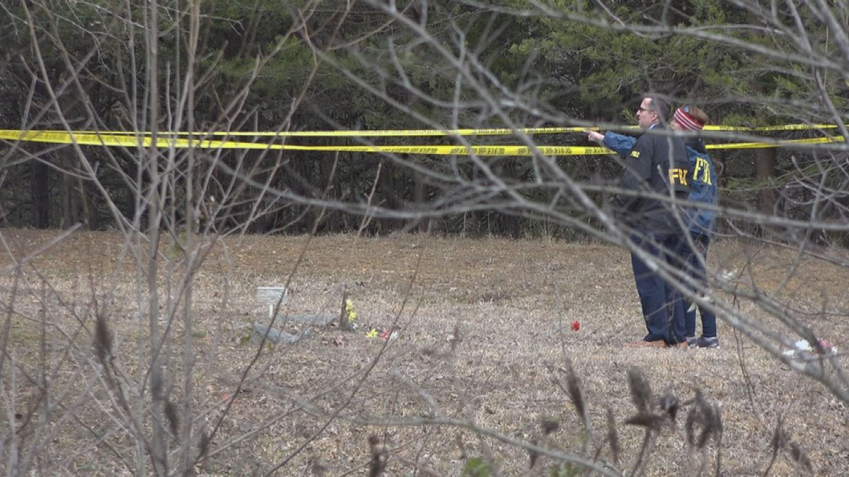 FBI officials investigated the area where a woman's body was found Monday morning in Mammoth...