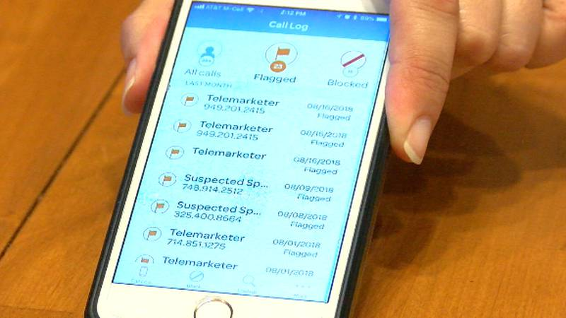 Van Andel shows the AT&T app that filters spam calls for customers.