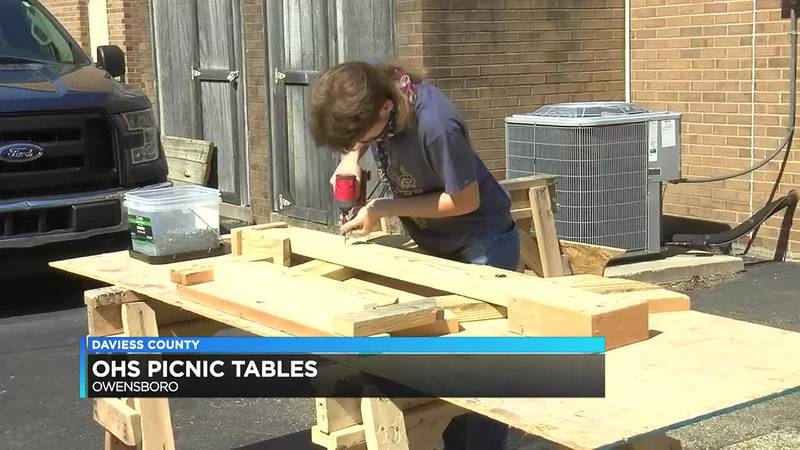 Owensboro H.S. carpentry students selling picnic tables